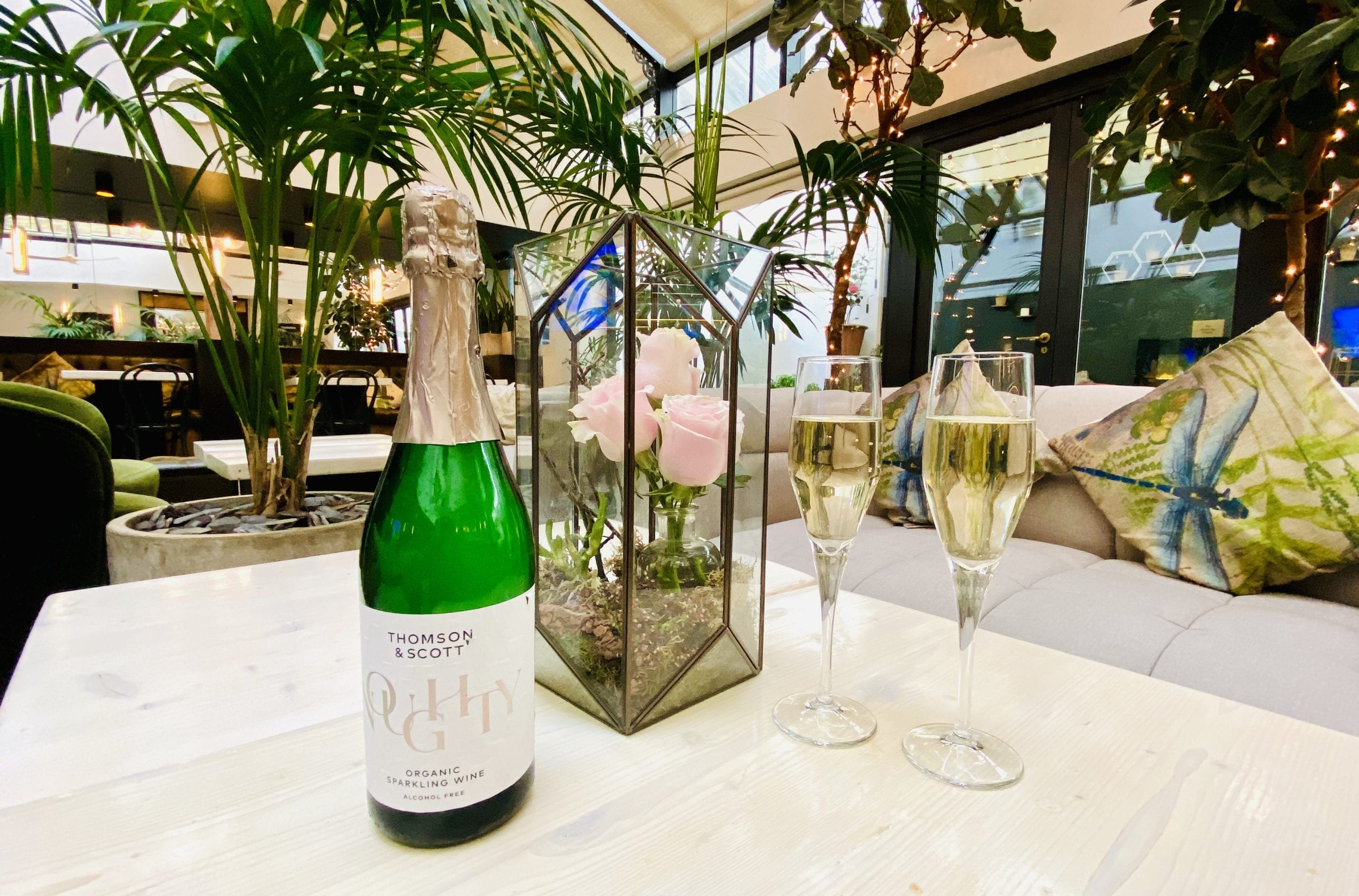 Bottle of Alcohol-Free Sparkling Wine and two glasses served in The Living Room at My Chelsea